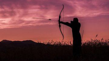 Shoowing a bow at sunset