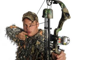 Archer Using Sight on Compound Bow