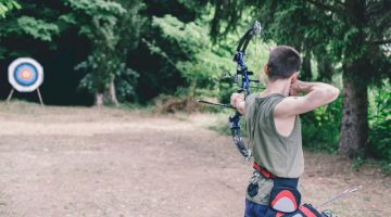 Boy Shooting Compound Bow